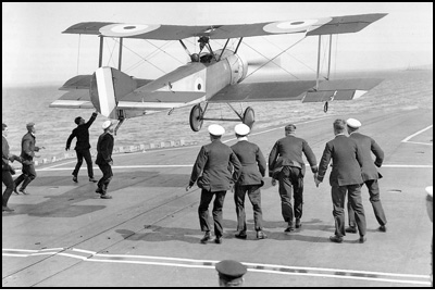 Squadron Commander Edwin Dunning landing an aircraft on the deck of a moving ship.