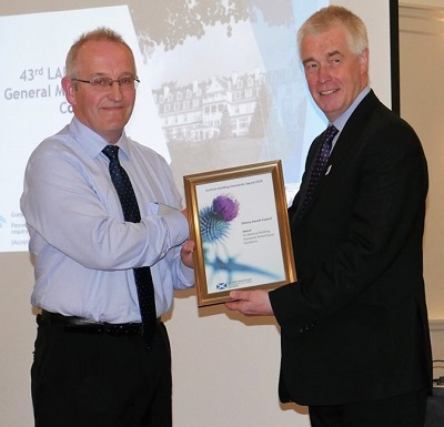 Jack Leslie – Orkney Islands Council being presented with the award by Stephen Garvin BSD.